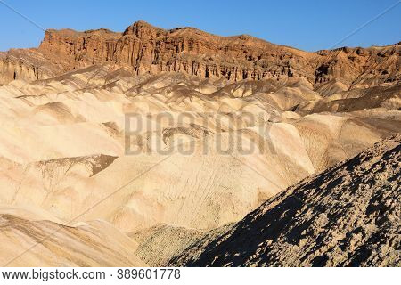 Eroded Barren Hills Surrounded By A Rural Canyon Taken On Arid Badlands At The Mojave Desert In Deat