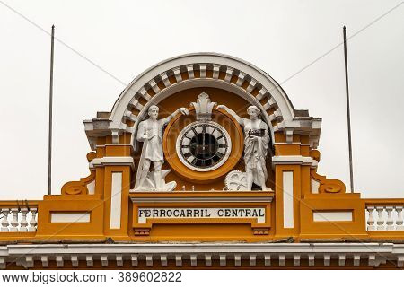 Lima, Peru - December 4, 2008: Closeup Of Clock Piece With Statues On Top Of Facade Of Yellow And Wh