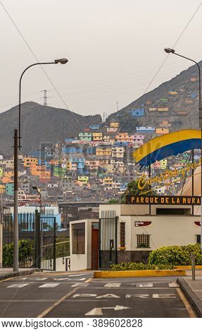Lima, Peru - December 4, 2008: Colorful Pallet Of Poor Neighborhood Houses Built On Flank Of Tall Mo