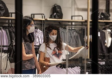 Belgrade, Serbia - September 25, 2020: Clients, Women, Looking At Tshirts In A Fashion Retailer Clot