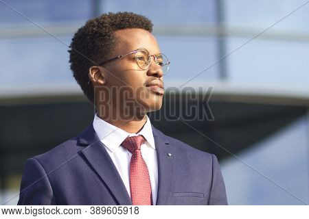Close Up Portrait Of Serious Confident Successful Businessman In Suit, Tie, Glasses. Black African A
