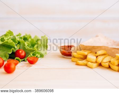 Healthy Vs Unhealthy Food, Dieting Concept. Lettuce Salad, Cherry Tomatoes On Left Side And French F