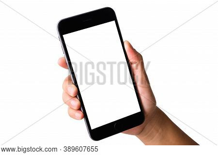 Woman Hand Holding A Smartphone Blank White Screen. Female Holds The Modern Mobile Phone On Hands St