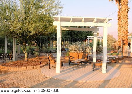 October 5, 2020 In Furnace Creek, Ca:  Rustic Gazebo Furnished With Tables And Chairs Surrounded By