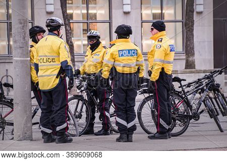 Toronto, Canada - 01 04 2020: Toronto Police Bicycle Patrol Officers Guarding The University Avenue