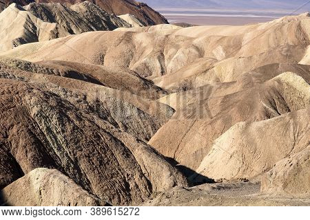 Rolling Eroded Barren Hills Surrounding Canyons Taken At Zabriskie Point In Death Valley National Pa