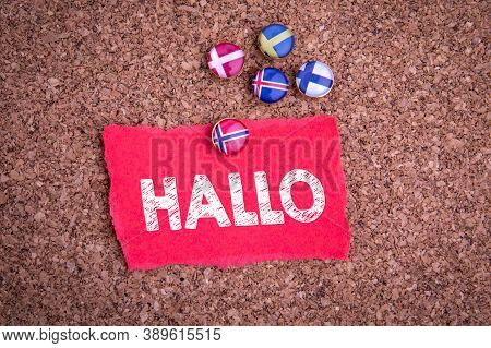 Hello In Norwegian Means Hallo. Norwegian Flag On A Pin. Sheet Of Paper On A Cork Background