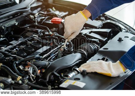 Close Up Hand Auto Mechanic Check Engine New Car In Car Service Center.