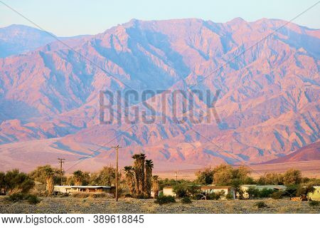 Community Of Furnace Creek, Ca With A Residential Area Surrounded By Barren Mountains Taken In Death