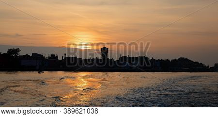 Sunset View Of Burano Island From The Sea. Venice, Italy.