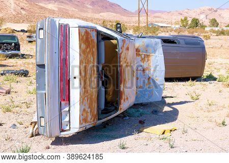 October 5, 2020 In Beatty, Nv:  Abandoned Cars On An Arid Field At An Unofficial Junkyard Taken In B