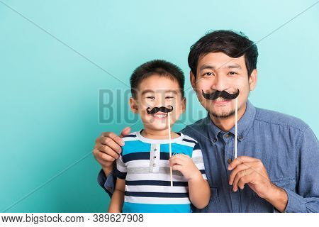 Family Funny Happy Hipster Father And His Son Kid Holding Black Mustache Props For The Photo Booth C
