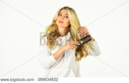 Invest In Your Hair. Fashion Photo Of Beautiful Lady. Woman Curling Hair. Sexy Woman Has Long Curly