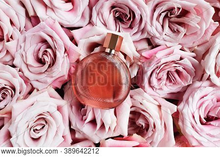Perfume Bottle And Light Pink Roses. Top View, Flatlay, Mock Up. Eau De Toilette.