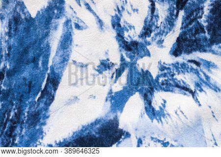 Tie-dye Cotton Fabric Texture Blue And White Paint Colors. Ancient Resist-dyeing Textile Coloring Te