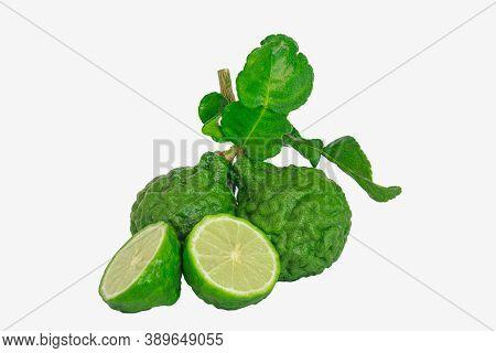 Bergamot Fruit  Cut  Half With Leaf  On Isolated White Background.