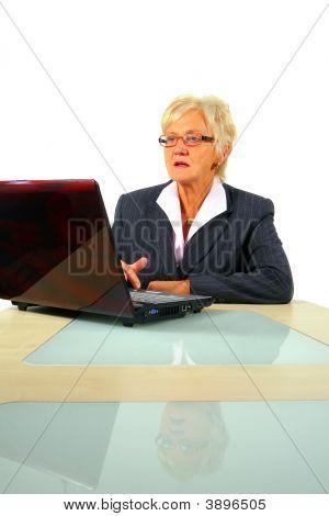Senior Businesswoman Working On Laptop