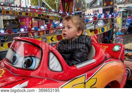 Portrait Of A Little Boy In A Merry-go-round