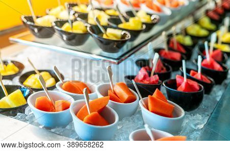 Tropical Fruit Buffet At Event In Restaurant. Catering Food. Fresh Papaya, Watermelon And Pineapple