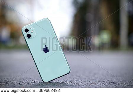 Saint-petersburg, Russia - 09.09.2020. Shockproof Iphone 11 Falling, Crashes On Asphalt, Broken Appl