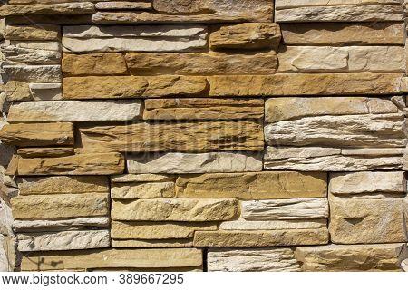 Horizontally Aligned Limestone Wall Stone Blocks. Colorful Texture Of The Limestone Walls. Limestone