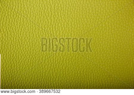 Green Leather Background. Green Leather Texture Closeup Background. Structured Background Design Lea