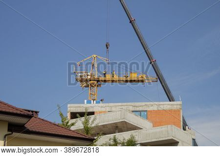 Dismantling And Assembling A Construction Crane. Dismantling A Tower Crane With Another Crane. Speci