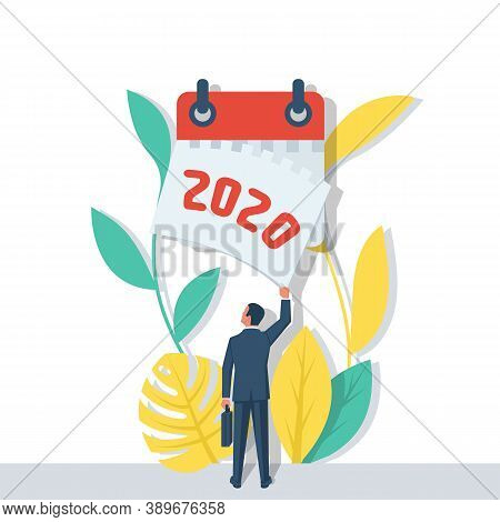 Goodbye 2020. A Businessman Tears Off A Calendar Sheet Of The Outgoing Year. Parting With Coming Yea