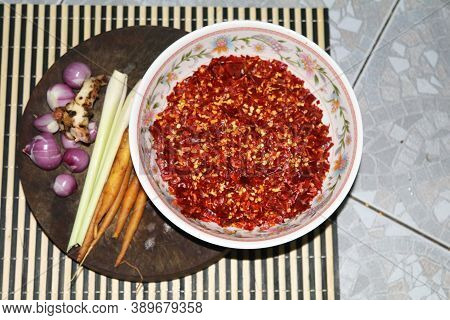 Ingredients - Red Curry Paste - In A White Bowl And Garlic, Shallots, Lemongrass, Dried Chilies, Kaf