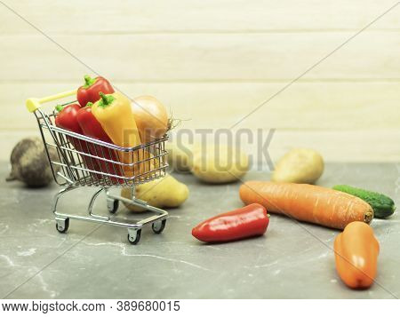 Fresh And Healthy Vegetables In The Basket. Vegetables In An Iron Basket As A Background With Place