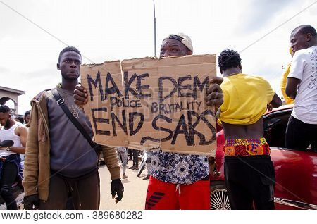 Lagos, Nigeria - October 12, 2020: Group Of Nigerian Youths Protesting Around The City About End Sar