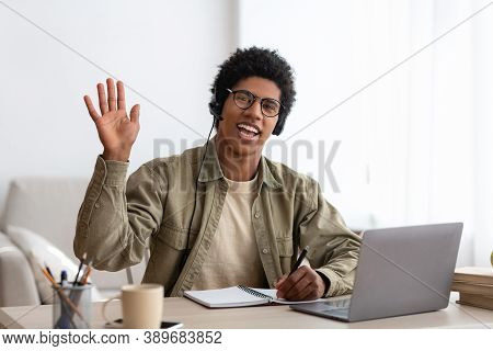 Web-based Communication Concept. Black Teen Guy Talking To His College Tutor On Laptop Computer From