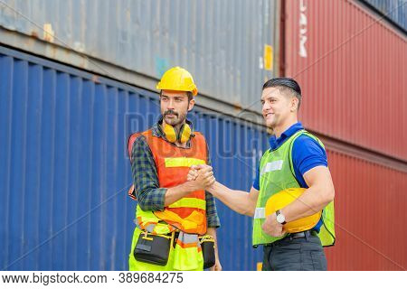 Engineer And Worker Soul Brother Handshake, Thumb Clasp Handshake Or Homie Handshake With Blurred Co