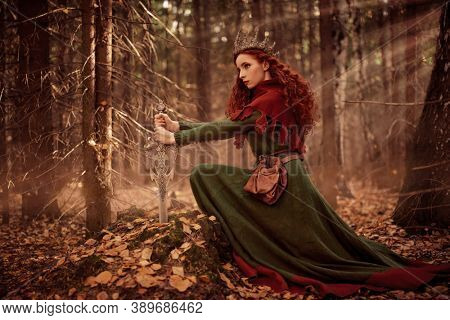 A beautiful queen warrior woman with a sword in a deep forest. Ancient legends. Fantasy world.