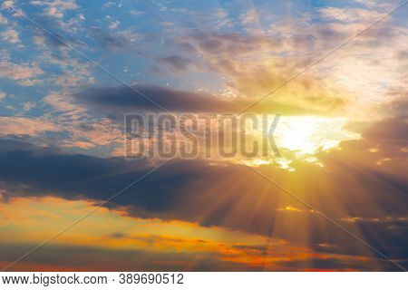 Beautiful Bright Sunset In The Cloudy Sky