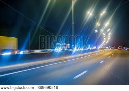 Night Illuminated Highway With Moving Cars Photo