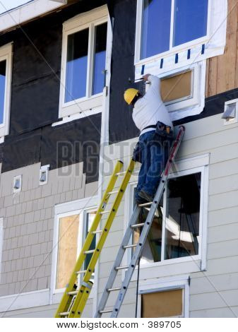 Man Hanging Siding - Construction