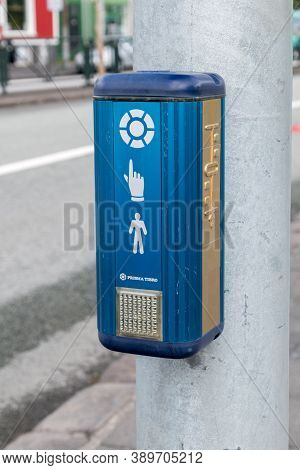 Reykjavik, Iceland - June 20, 2020: Pedestrian Touch Button For Crossroad With Traffic Lights In Ice