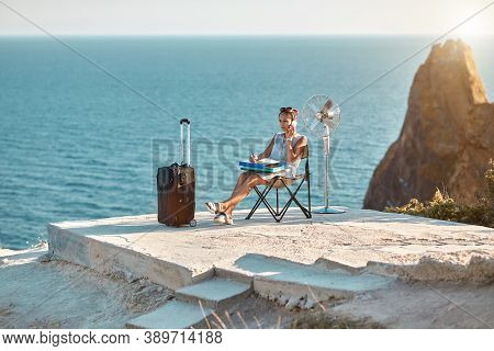 Woman With Laptop Working On Beach. Seascape On Background. Lifestyle Change, Dream Job Concept. Bus