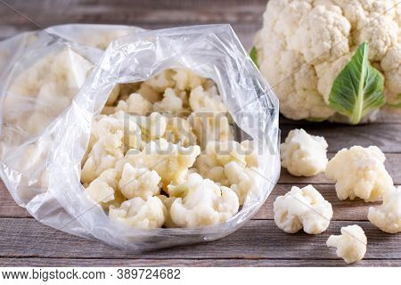 Frozen Cauliflower Florets On Wooden Table, Healthy Diet Food, Closeup