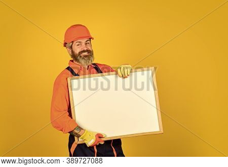 Troubleshoot Concept. Repairman Hold Whiteboard Copy Space. Handsome Repairman. Bearded Man Repairma