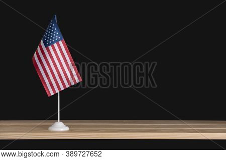 National Flag Of America On Flag Pole, Black Background. Flag Of United States Of America. Copy Spac