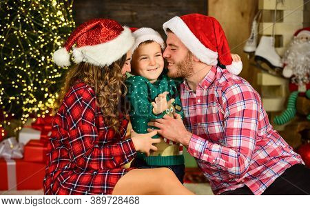 Parents And Child Christmas Eve. Parenthood Happiness. Happy Holidays. Christmas Tradition. Father M