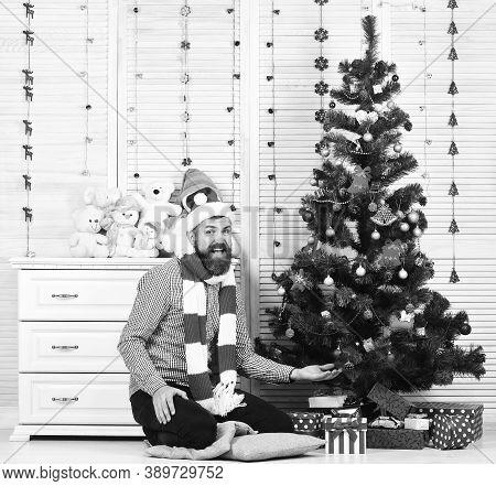 Santa Claus With Happy Face Near Bureau With Toys
