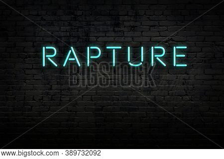 Neon Sign On Brick Wall At Night. Inscription Rapture