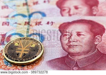 One Hundred Yuan Banknotes, Next To An E-rmb Gold Coin, Digital Version Of The Yuan. Concept Of New