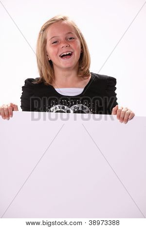 Happy Cheerful Preteen Girl Holding A Sign