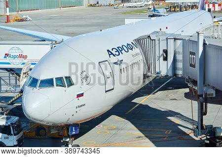 Moscow, Russia - September 16, 2020: Boarding Passengers On A Plane Using A Jet Bridge And Loading B