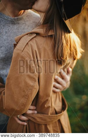 Stylish Couple Embracing In Autumn Meadow In Warm Sunset Light, Gentle Hug Close Up