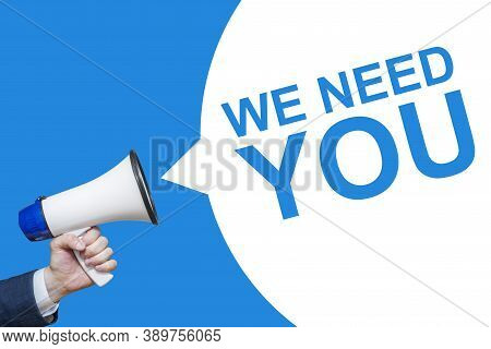 Male Hand Holding A Megaphone With We Need You Bubble. Speaker. Banner For Business, Marketing And A